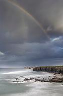 Storm clouds and rainbow over the rocky coast in the afternoon, Galicia, Spain<br /> <br /> Gewitterwolken und Regenbogen über der Felsküste am Nachmittag, Galizien, Spanien