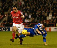 Fotball<br /> England 2004/2005<br /> Foto: SBI/Digitalsport<br /> NORWAY ONLY<br /> <br /> Nottingham Forest v Reading<br /> <br /> Coca Cola Championship. 20/11/2004.<br /> <br /> Reading's Graeme Murty (R) makes a challenge on Andy Reid, for which he was shown a yellow card.