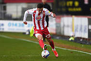 Stevenage forward Jack Aitchison (27)  plays a pass during the EFL Sky Bet League 2 match between Stevenage and Carlisle United at the Lamex Stadium, Stevenage, England on 20 March 2021.