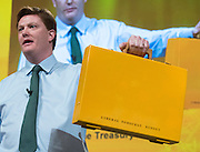"""© Licensed to London News Pictures. 14/03/2015. Liverpool, UK. Chief Secretary to the Treasury and Liberal Democrat Danny Alexander holds up a yellow ministerial briefcase with the words """"Liberal Democrat Budget"""" The Liberal Democrat Spring Conference in Liverpool 14th March 2015. Photo credit : Stephen Simpson/LNP"""