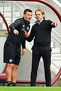 Heart of Midlothian assistant manager, Lee McCulloch speaks with Heart of Midlothian manager Robbie Neilson during the Cinch SPFL Premiership match between Heart of Midlothian and Hibernian at Tynecastle Park, Edinburgh, Scotland on 12 September 2021.
