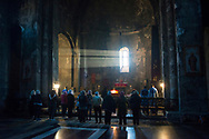 People and clergy participate in a service at Sts. Paul and Peter Church in Tatev Monastery in Tatev, Armenia.