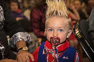 19 month  Curtis Ray Jeffrey II, a professional baby model whose hair is worn to mimic Trumps  from f Bluff Creek, LA ,at a campaign rally in Baton Rouge, LA for Republican presidential candidate Donald Trump, before he arrives.