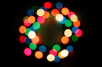 9 December 2012: Christmas wreath holiday lights out of focus. Graphic Art