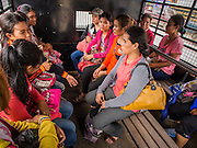 16 JUNE 2014 - ARANYAPRATHET, THAILAND: Cambodian women in a police truck in Aranyaprathet , Thailand wait to be returned to Cambodia. More than 150,000 Cambodian migrant workers and their families have left Thailand since June 12. The exodus started when rumors circulated in the Cambodian migrant community that the Thai junta was going to crack down on undocumented workers. About 40,000 Cambodians were expected to return to Cambodia today. The mass exodus has stressed resources on both sides of the Thai/Cambodian border. The Cambodian town of Poipet has been over run with returning migrants. On the Thai side, in Aranyaprathet, the bus and train station has been flooded with Cambodians taking all of their possessions back to Cambodia. PHOTO BY JACK KURTZ