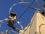 close up of new razor wire and surveillance camera