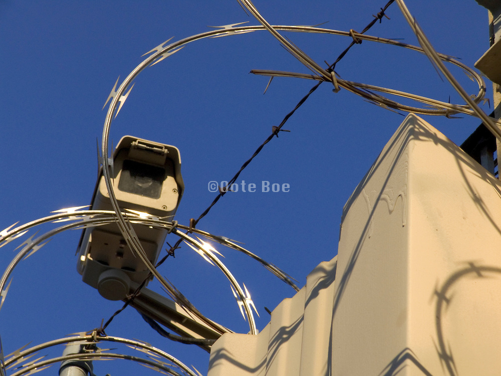 close up of new razor wire and surveillance camera