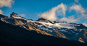 Sunrise in Dart Valley seen from Daley's Flat Hut in Mount Aspiring National Park, Otago region, South Island of New Zealand. This image was stitched from multiple overlapping photos.