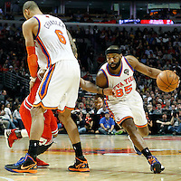 12 March 2012: New York Knicks point guard Baron Davis (85) drives past Chicago Bulls point guard Derrick Rose (1) on a screen set New York Knicks center Tyson Chandler (6) during the Chicago Bulls 104-99 victory over the New York Knicks at the United Center, Chicago, Illinois, USA.