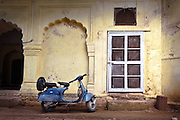 Blue Bike, Yellow Wall - Old Delhi, India