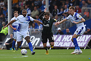 Stefan Payne (9) of Bristol Rovers and Tom Lockyer (4) of Bristol Rovers   hold off Graham Carey (10) of Plymouth Argyle during the EFL Sky Bet League 1 match between Bristol Rovers and Plymouth Argyle at the Memorial Stadium, Bristol, England on 8 September 2018.