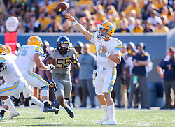 Sep 11, 2021; Morgantown, West Virginia, USA; Long Island Sharks quarterback Camden Orth (12) throws a pass during the first quarter against the West Virginia Mountaineers at Mountaineer Field at Milan Puskar Stadium. Mandatory Credit: Ben Queen-USA TODAY Sports