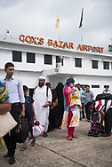 Passengers wait in line to board a flight to Dhaka at Cox's Bazar airport in Bangladesh