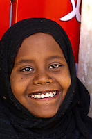 Nubian girl wearing head scarf, Nubian village near Aswan, Egypt