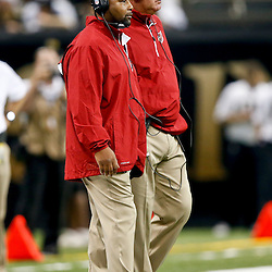 Sep 22, 2013; New Orleans, LA, USA; Arizona Cardinals head coach Bruce Arians (right) and cornerbacks coach Kevin Ross (left) during a game against the New Orleans Saints at Mercedes-Benz Superdome. The Saints defeated the Cardinals 31-7. Mandatory Credit: Derick E. Hingle-USA TODAY Sports