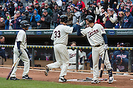 Justin Morneau #33 of the Minnesota Twins is congratulated by Trevor Plouffe #24 after hitting a home run against the New York Mets on April 13, 2013 at Target Field in Minneapolis, Minnesota.  The Mets defeated the Twins 4 to 2.  Photo: Ben Krause