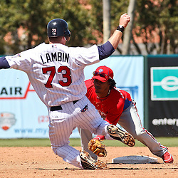 March 13, 2011; Fort Myers, FL, USA; Philadelphia Phillies shortstop Michael Martinez (19) tags out Minnesota Twins right fielder Chase Lambin on an attempted steal at second base during a spring training exhibition game at Hammond Stadium.  Mandatory Credit: Derick E. Hingle-US PRESSWIRE