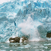 Cordillera Sarmiento, Patagonia, Chile.  A serac calves from glacier draining highest peaks of this previously unexplored range.
