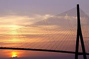 The bridge of Normandy, built by Bouygues, is pictured at sunset, near Le Havre, France, on July 2, 2005. Photographer: Lucas Schifres/Bloomberg News.