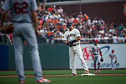 San Francisco Giants second baseman Joe Panik (12) relaxes at second base after hitting a double against the St. Louis Cardinals at AT&T Park in San Francisco, California, on September 3, 2017. (Stan Olszewski/Special to S.F. Examiner)