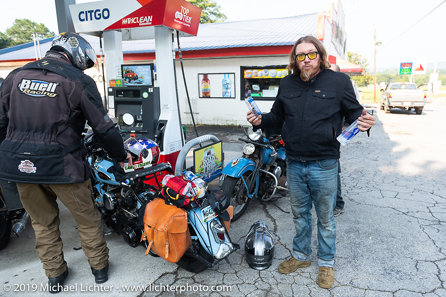 CCC event promoter Jason Sims at a gas stop during the Cross Country Chase motorcycle endurance run from Sault Sainte Marie, MI to Key West, FL. (for vintage bikes from 1930-1948). Stage-6 from Chattanooga, TN to Macon, GA USA covered 258 miles. Wednesday, September 11, 2019. Photography ©2019 Michael Lichter.