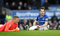 Football - 2017 / 2018 Premier League - Everton vs. Manchester City<br /> <br /> Leighton Baines and Jordan Pickford of Everton react after Raheem Sterling of Manchester City scores the third goal at Goodison Park.<br /> <br /> COLORSPORT/LYNNE CAMERON