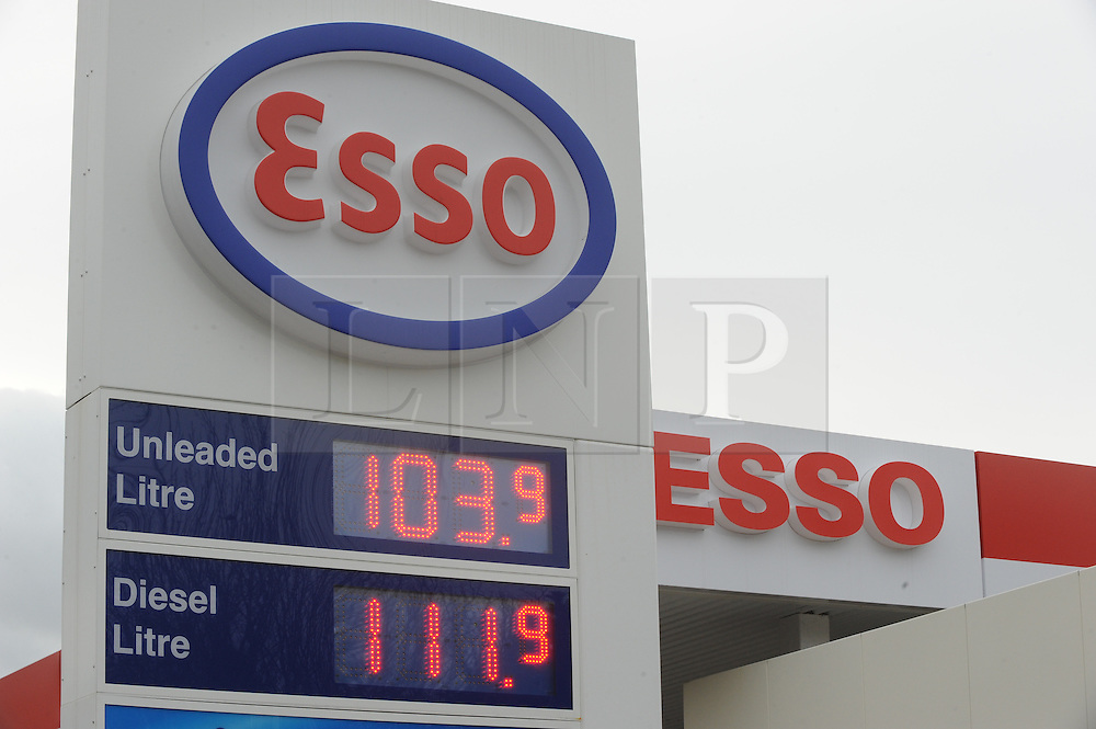 © Licensed to London News Pictures. 26/01/2015<br /> Petrol prices are slowly coming down in price. At this Esso station on Sedlescombe Road North in Hastings,East Sussex unleaded is 103.9 litre.<br /> (Byline:Grant Falvey/LNP)