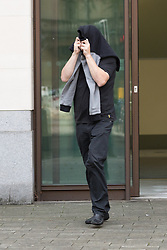 © Licensed to London News Pictures. 27/98/2015. London, UK. Brenn Walters (also known as Ben Perkins) leaving Westminster Magistrates Court in London today. Four defendants: Brenn Walters (also known as Ben Perkins), Terri Robinson, Laura Perkins and Steven Robinson were granted unconditional bail at a hearing today after appearing charged under the Proceeds of Crime Act 2002 in connection with the Hatton Garden raid. All four defendants covered themselves from waiting press as they left the court in a taxi. Photo credit : Vickie Flores/LNP
