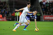 Nelson Oliveira of Swansea city breaks away from Chelsea's Nemanja Matic.Barclays Premier League match, Swansea city v Chelsea at the Liberty Stadium in Swansea, South Wales on Saturday 17th Jan 2015.<br /> pic by Andrew Orchard, Andrew Orchard sports photography.