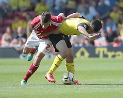 Watford's Fernando Forestieri and Nottingham Forest's Eric Lichaj fight it out  - Photo mandatory by-line: Nigel Pitts-Drake/JMP - Tel: Mobile: 07966 386802 25/08/2013 - SPORT - FOOTBALL -Vicarage Road Stadium - Watford -  Watford v Nottingham Forest - Sky Bet Championship