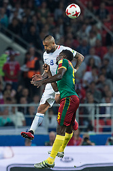 Arturo VIdal of Chile (up) vies for the ball with Michael Ngadeu Ngadjui of Cameroon (bottom) during the FIFA Confederations Cup-2017 football match in group B between Cameroon and Chile in Moscow, Russia, on June 18, 2017. (Credit Image: © Evgeny Sinitsyn/Xinhua via ZUMA Wire)