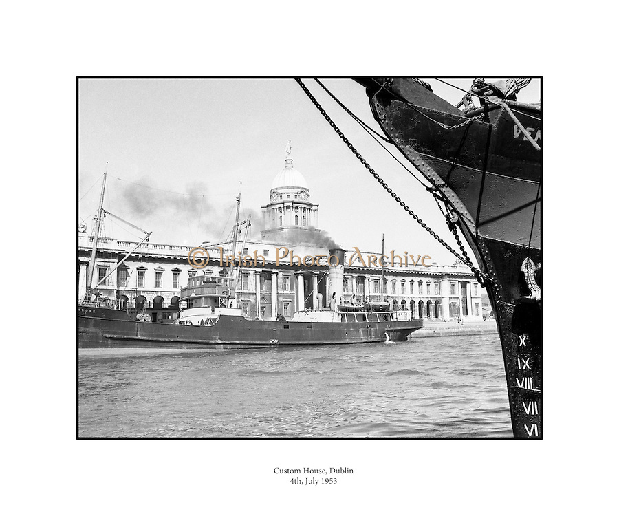 Views of Custom House,  ships on the liffey Dublin.04/07/1953..The Custom House was built between 1781 and 1791 by James Gandon. It was seized by the Dublin Brigade of the IRA in May of 1921 and they set the Custom House on fire.  In 1926, it was decided that the Custom House would be rebuilt on its existing location with little change to the exterior. ..http://anchorhousedublin.com/dublin_guide/the-customs-house-dublin-1/
