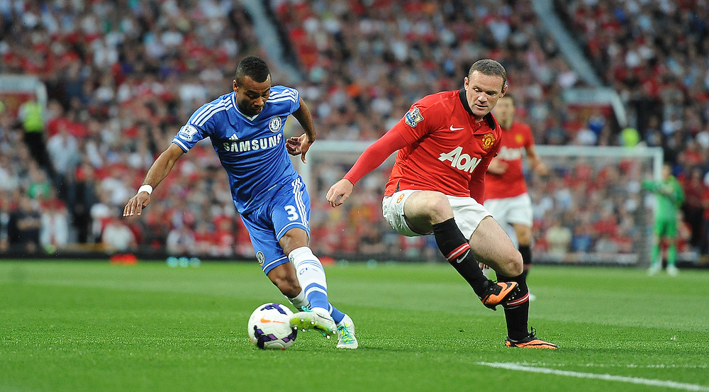 Chelsea's Ashley Cole and Manchester United's Wayne Rooney<br /> <br /> Photo by Stephen White/CameraSport<br /> <br /> Football - Barclays Premiership - Manchester United v Chelsea - Monday 26th August 2013 - Old Trafford - Manchester<br /> <br /> © CameraSport - 43 Linden Ave. Countesthorpe. Leicester. England. LE8 5PG - Tel: +44 (0) 116 277 4147 - admin@camerasport.com - www.camerasport.com