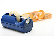 Cutout of a Blue plastic tape dispenser and rolls F sticky tape on white background