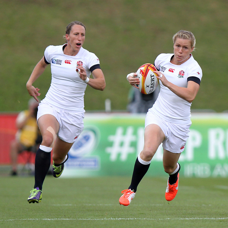 Danielle Waterman on the charge with Kat Merchant in support. England v Canada Pool A match at WRWC 2014 at Centre National de Rugby, Marcoussis, France, on 9th August 2014