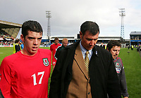 Photo: Andrew Unwin.<br />Northern Ireland v Wales. World Cup Qualifier.<br />08/10/2005.<br />Northern Ireland's Lawrie Sanchez (R) walks off with Wales' Richard Duffy (L).