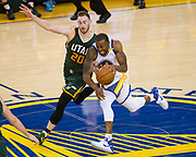 Golden State Warriors forward Andre Iguodala (9) tries to beat Utah Jazz forward Gordon Hayward (20) down the court during Game 1 of the Western Conference Semifinals at Oracle Arena in Oakland, Calif., on May 2, 2017. (Stan Olszewski/Special to S.F. Examiner)