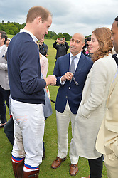 HRH THE DUKE OF CAMBRIDGE talks to STANLEY TUCCI and FELICITY BLUNT at the Audi Polo Challenge at Coworth Park, Blacknest Road, Ascot, Berkshire on 31st May 2015.