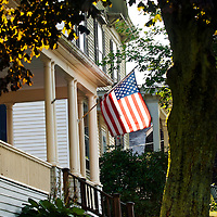 Old glory, the American flag flies from a front porch in Damariscotta, Maine