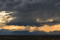 I had to pull off of I-90 to shoot this distant view of a thunderstorm rolling out of the Bighorn Mountains. But I nearly got stuck on a muddy road.