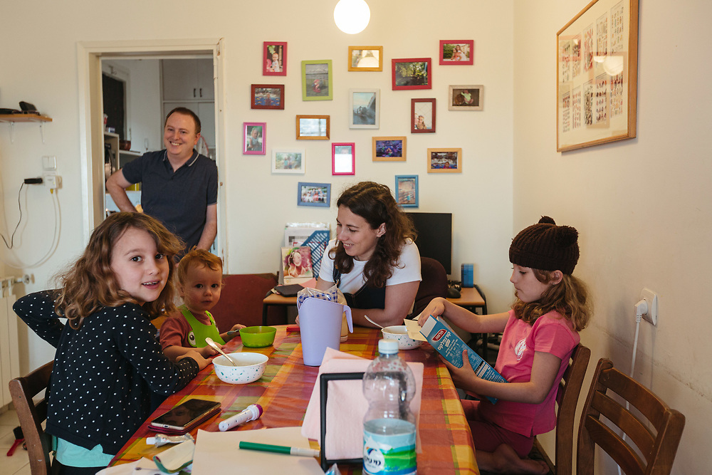 Twin girls Clil (R) and Alma (L), their brother Ofek, and parents Anna and Matti Michel, are seen during breakfast, at their home in Jerusalem, Israel, on May 3, 2020.