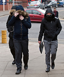 © Licensed to London News Pictures. 28/02/2012. Uxbridge, UK.  British Airways steward Matthew Davis (Right) from Crawley, West Sussex arriving at Uxbridge Magistrates Court today (28/02/2012) where he faced charges of communicating a bomb threat. Davis is accused of writing a message on a toilet door that caused the scare on a flight from Tokyo to London on February 12th. Photo credit : Ben Cawthra/LNP