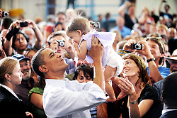US President Barack Obama holds up a baby after a town hall-style meeting in a hangar at Gallatin Field Airport in Belgrade, Montana, USA on August 14, 2009. Photo by Olivier Douliery/ABACAPRESS.COM  | 205501_001 Belgrade