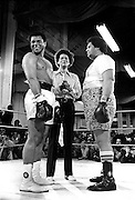 """Muhammad Ali faces off against Atlanta (GA) Mayor Maynard Jackson in a charity fundraiser in Atlanta, GA in 1973. Officiating (middle) is Julian Bond, then President of the Southern Christian Leadership Council (SCLC). -- Determine pricing and license this image, simply by clicking """"Add To Cart"""" below --"""