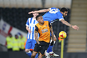 Brighton central defender, Connor Goldson (17) beats Hull City striker Abel Hernandez (9) during the Sky Bet Championship match between Hull City and Brighton and Hove Albion at the KC Stadium, Kingston upon Hull, England on 16 February 2016.