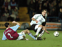 Picture: Henry Browne.<br /> Date: 11/02/2004.<br /> Fulham v Aston Villa FA Barclaycard Premiership.<br /> <br /> Carlos Bocanegra of Fulham flies in with a 2 footed challenge on Mark Delaney of Villa and gets sent off for it.
