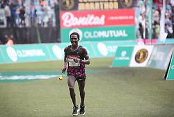 10062018 (Durban) A 10th position Nkosinathi Duma, RSA (5:47:09) run towards the finnish line during the 2018 Comrades marathon in Durban.<br /> Picture: Motshwari Mofokeng/ANA
