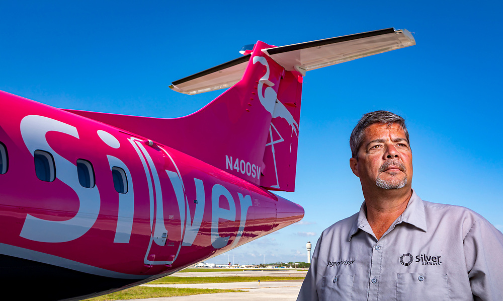 A Silver Airways maintenance supervisor stands before their newest aircraft, an ATR 42-500, at their facility in Orlando, Florida.<br />