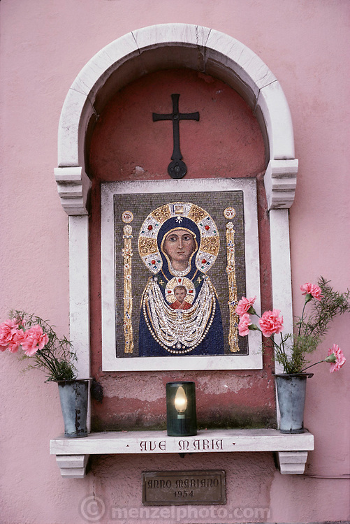 Small Ave Maria shrine on a back street in Murano, Italy.