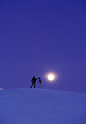 Fred Hirschmann photographing with Toyo 4x5 field camera the full moon rising over a wintry Kusawak Range, Northern British Columbia, Canada.